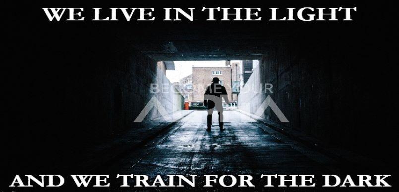 man standing in dark tunnel