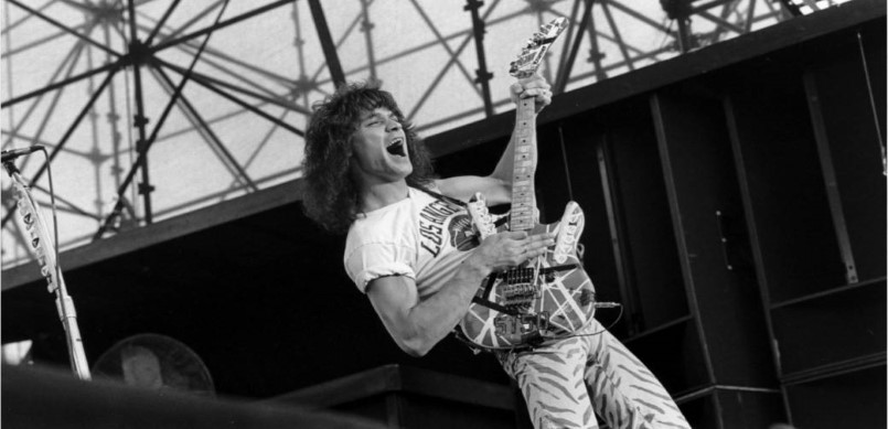 Eddie Van Halen black and white playing guitar