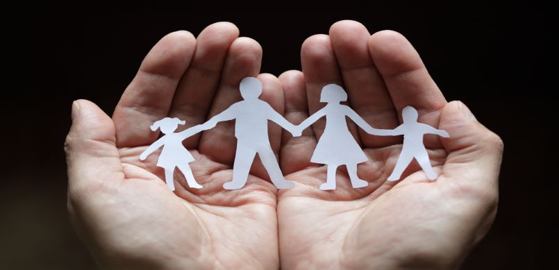 Family in palm of hand