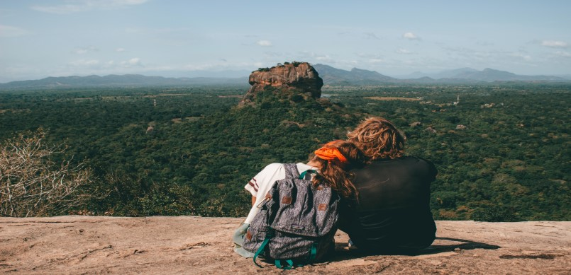 A couple on top of a mountain