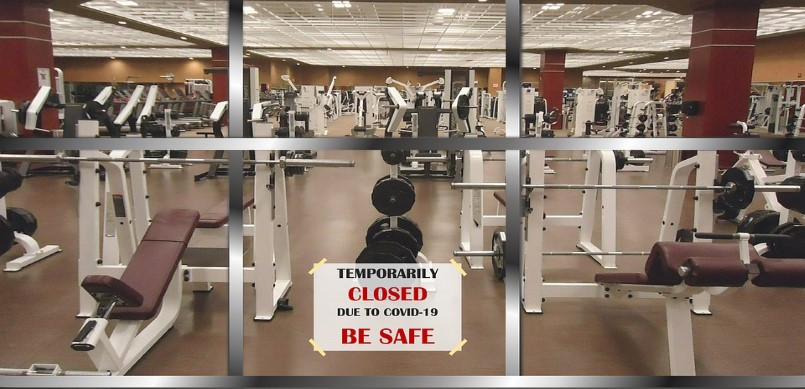 Gym with closed sign due to COVID-19
