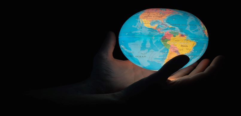 A globe in hands